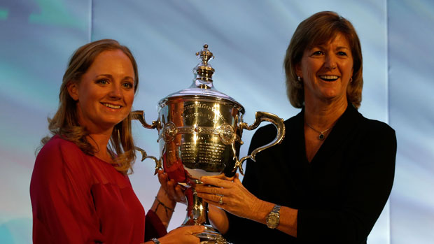 Stacy Lewis accepts Player of the Year Trophy from Beth Daniel