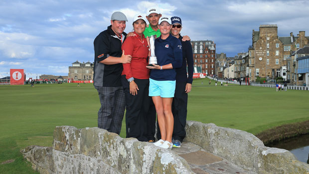 Stacy Lewis poses with her family and the trophy on the Swilcan Bridge
