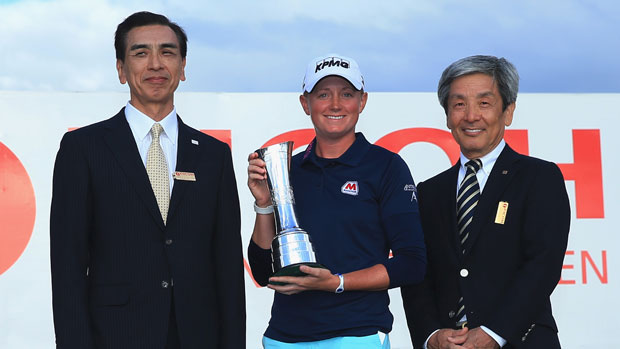 Stacy Lewis of the poses with the trophy and Zenji Miura and Simon Sasaki