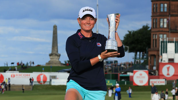 Stacy Lewis poses with the trophy on the Swilcan Bridge