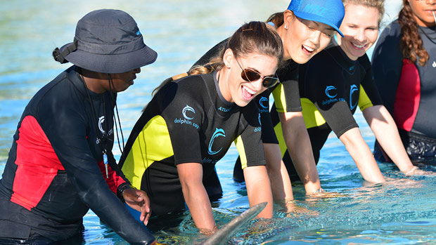 Belen Mozo and Michelle Wie swim with the dolphins