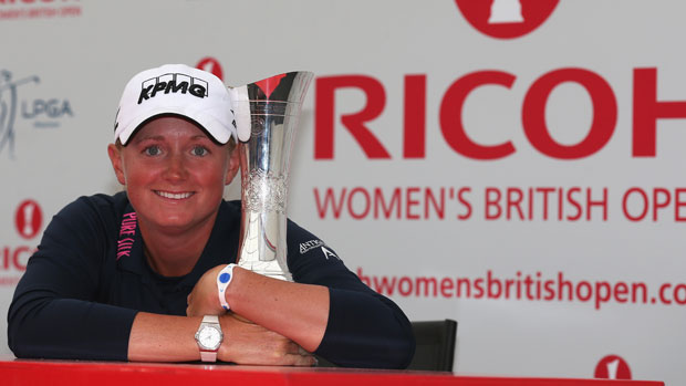 Stacy Lewis poses with the trophy at a press conference