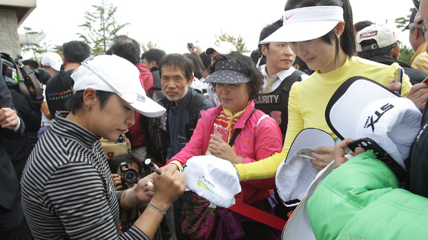Mi Hyun Kim signs her autograph for fans during the final round of KEB-HanaBank Championship