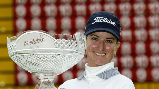 Karrie Webb with winner's trophy 2002.