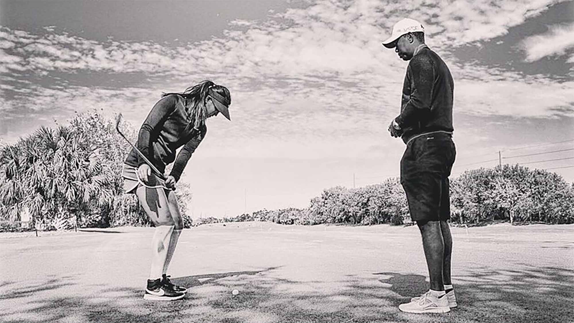 michelle wie teams up with tiger woods