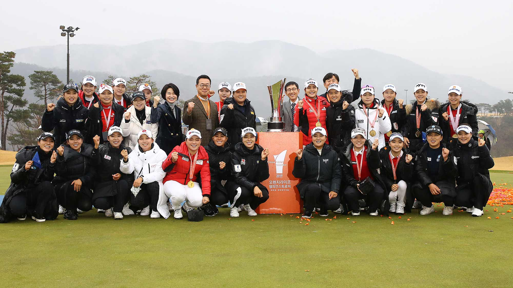 Teams from the LPGA and KLPGA pose after the KLPGA won the 2019 Orange Life Champions Trophy Inbee Park Invitational at Blue One The Honors Country Club in Gyeongju, Republic of Korea