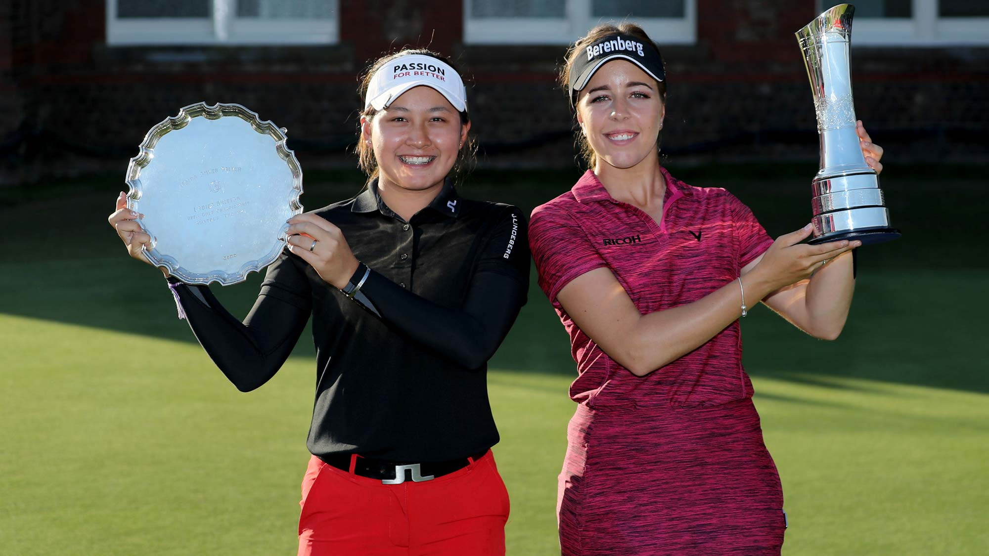 Georgia Hall of England holds the trophy after her victory with Atthaya Thitikul of Thailand the winner of the low amateur award in the final round of the Ricoh Women's British Open at Royal Lytham and St Annes Golf Club on August 5, 2018 in Lytham St Annes, England.
