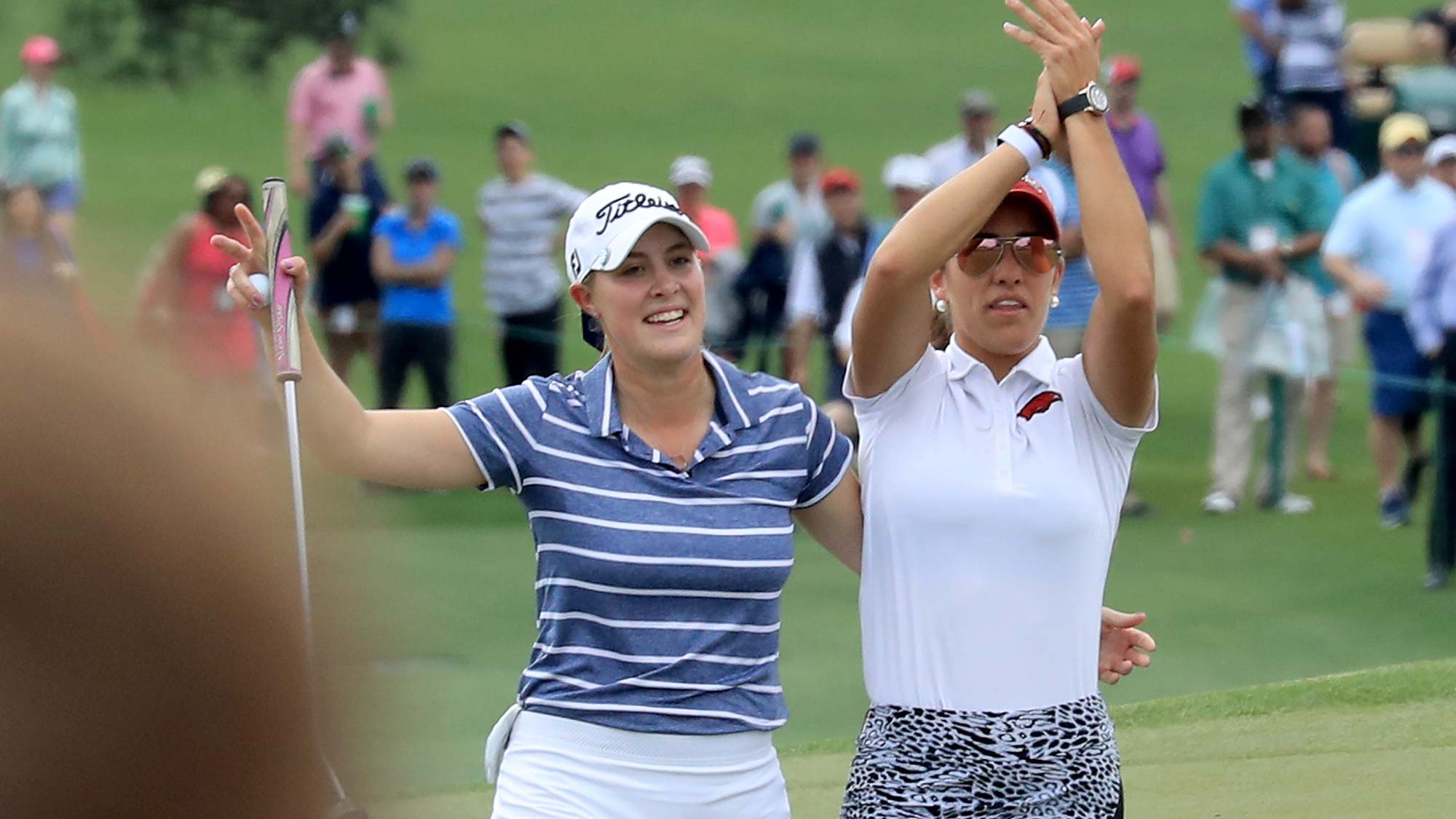 Jennifer Kupcho of the United States (L) is congratulated by her playing partner Maria Fassi of Mexico after holing a putt for birdie on the par 4, 18th hole as the patrons applaud during the final round of the inaugural Augusta National Women's Amateur Championship at Augusta National Golf Club