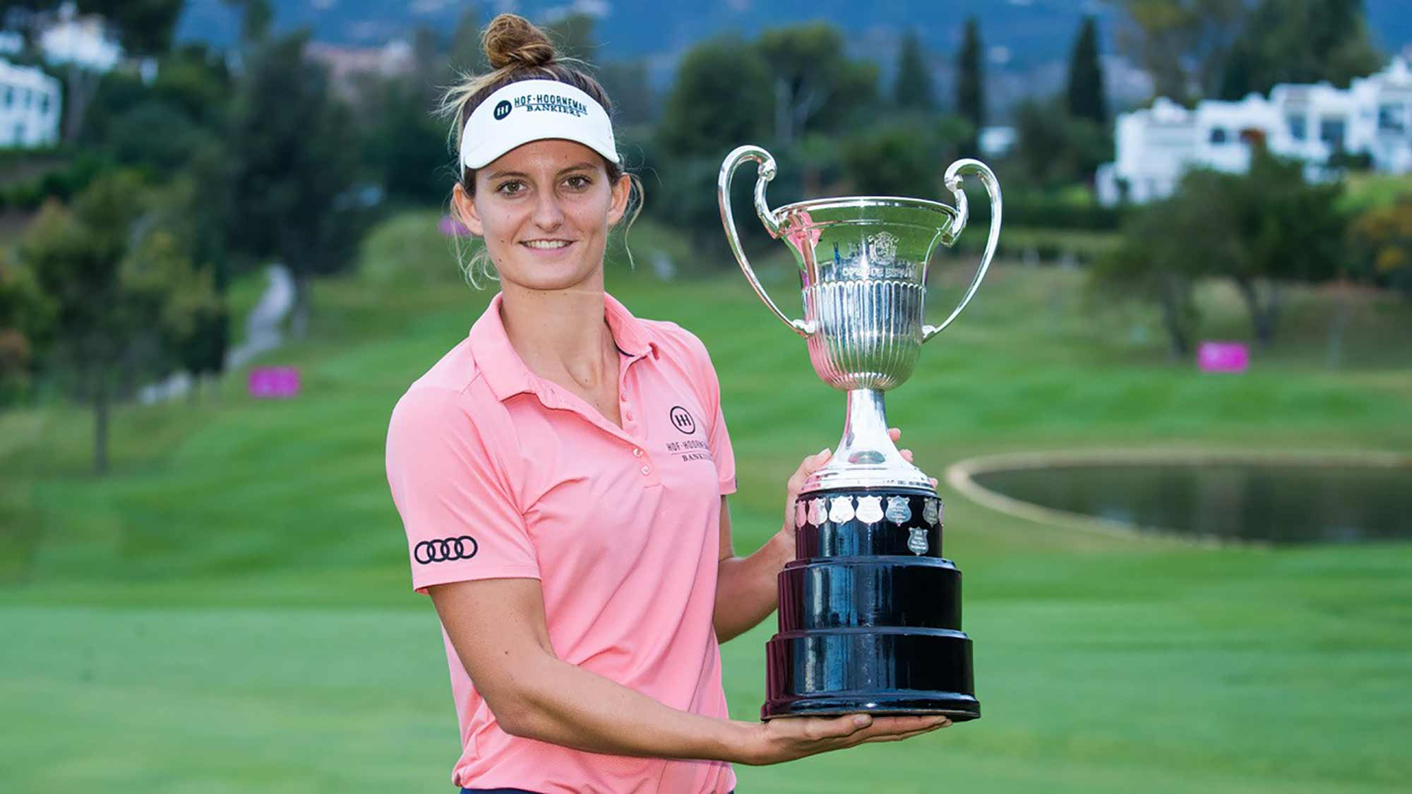 Anne van Dam poses with the trophy after successfully defending her title at the Andalucia Costa del Sol Open de Espana on the Ladies European Tour