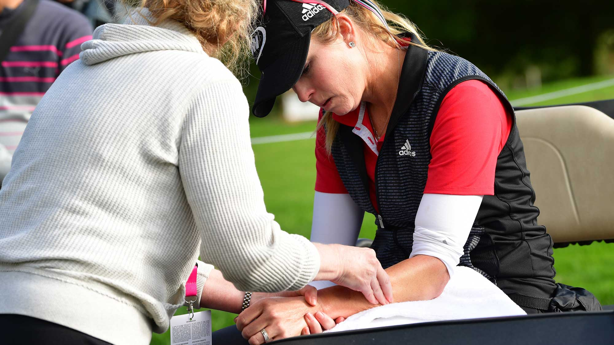 Paula Creamer of USA gets physio treatment for her sprained wrist during the weather delayed first round of The Evian Championship at Evian Resort Golf Club on September 15, 2017 in Evian-les-Bains, France.