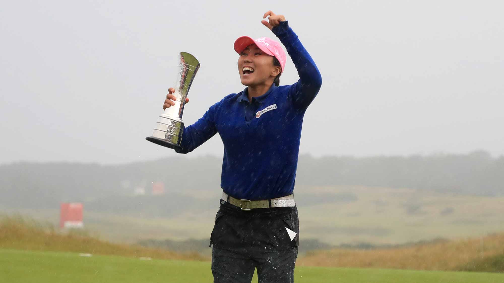 In-Kyung Kim of Korea celebrates with the trophy following her victory during the final round of the Ricoh Women's British Open at Kingsbarns Golf Links