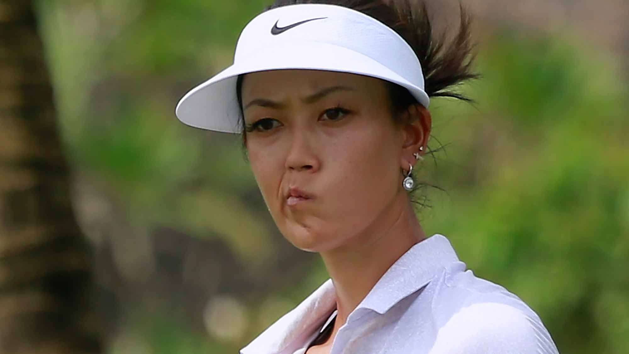 Michelle Wie of United States reacts after her putt at her putt at 18th hole during Round 2 of Blue Bay LPGA