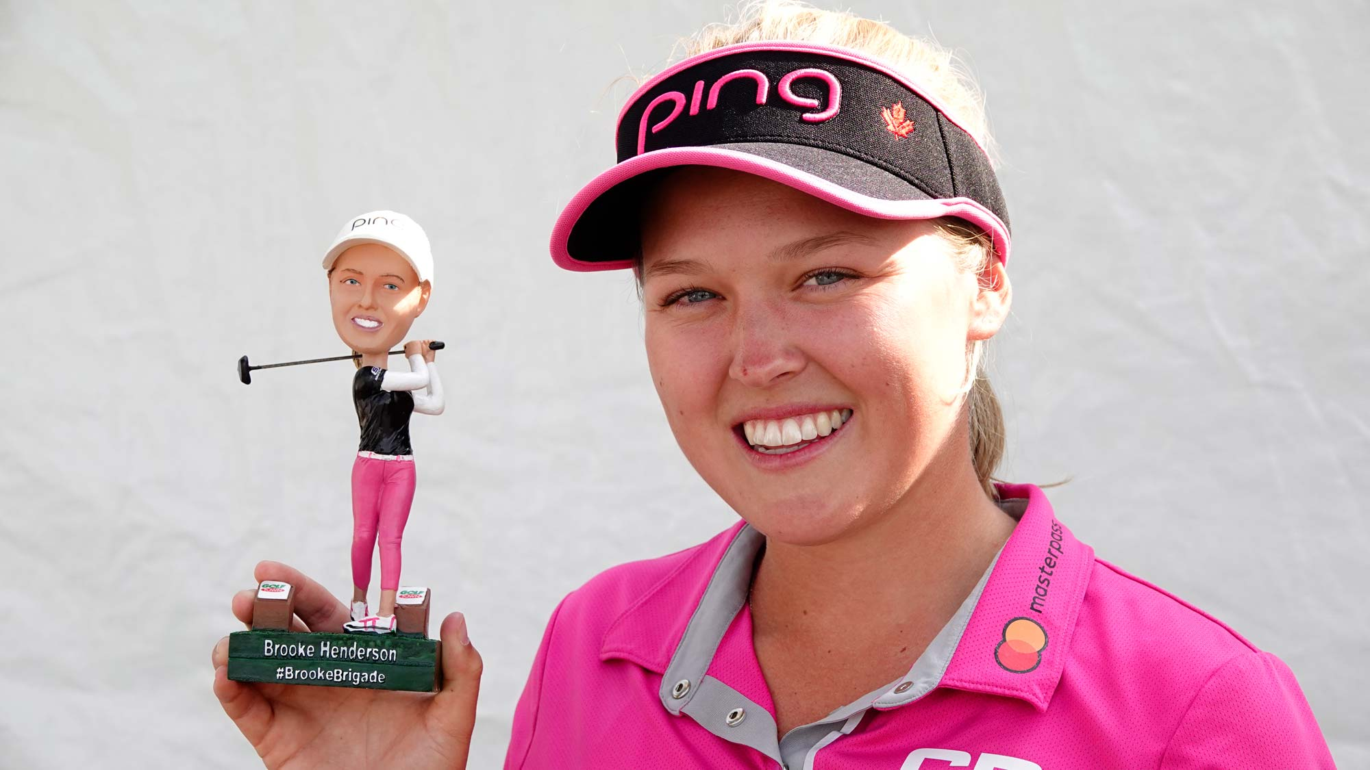 Brooke Henderson poses with her bobble head before the 2018 CP Women's Open