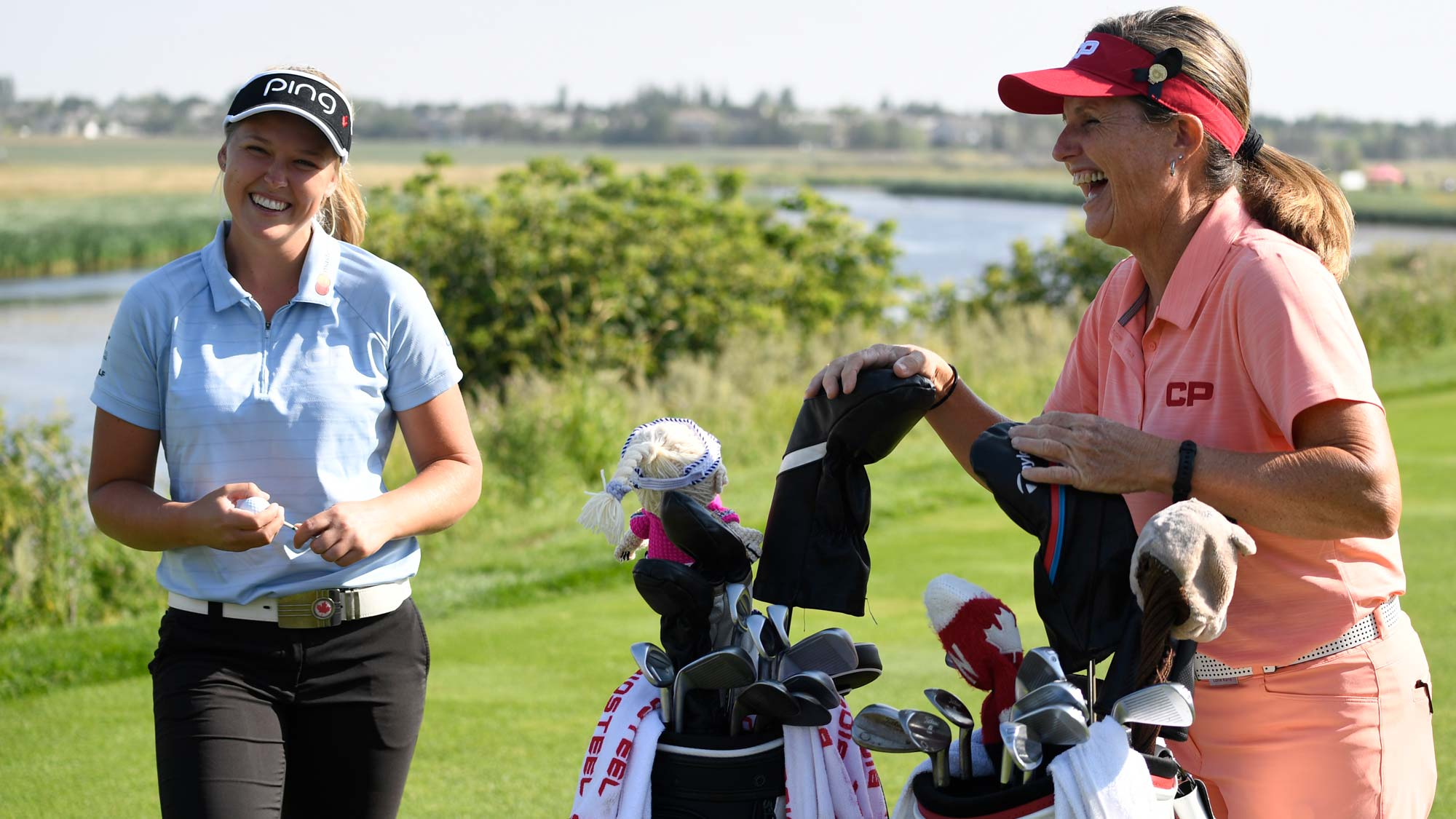 Brooke Henderson and Lorie Kane talk during the 2018 CP Women's Open ProAm