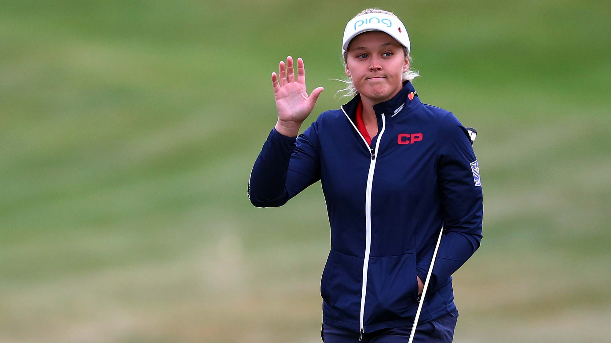Brooke Henderson of Canada waves to the crowd on the 1st green during the final round of the CP Womens Open