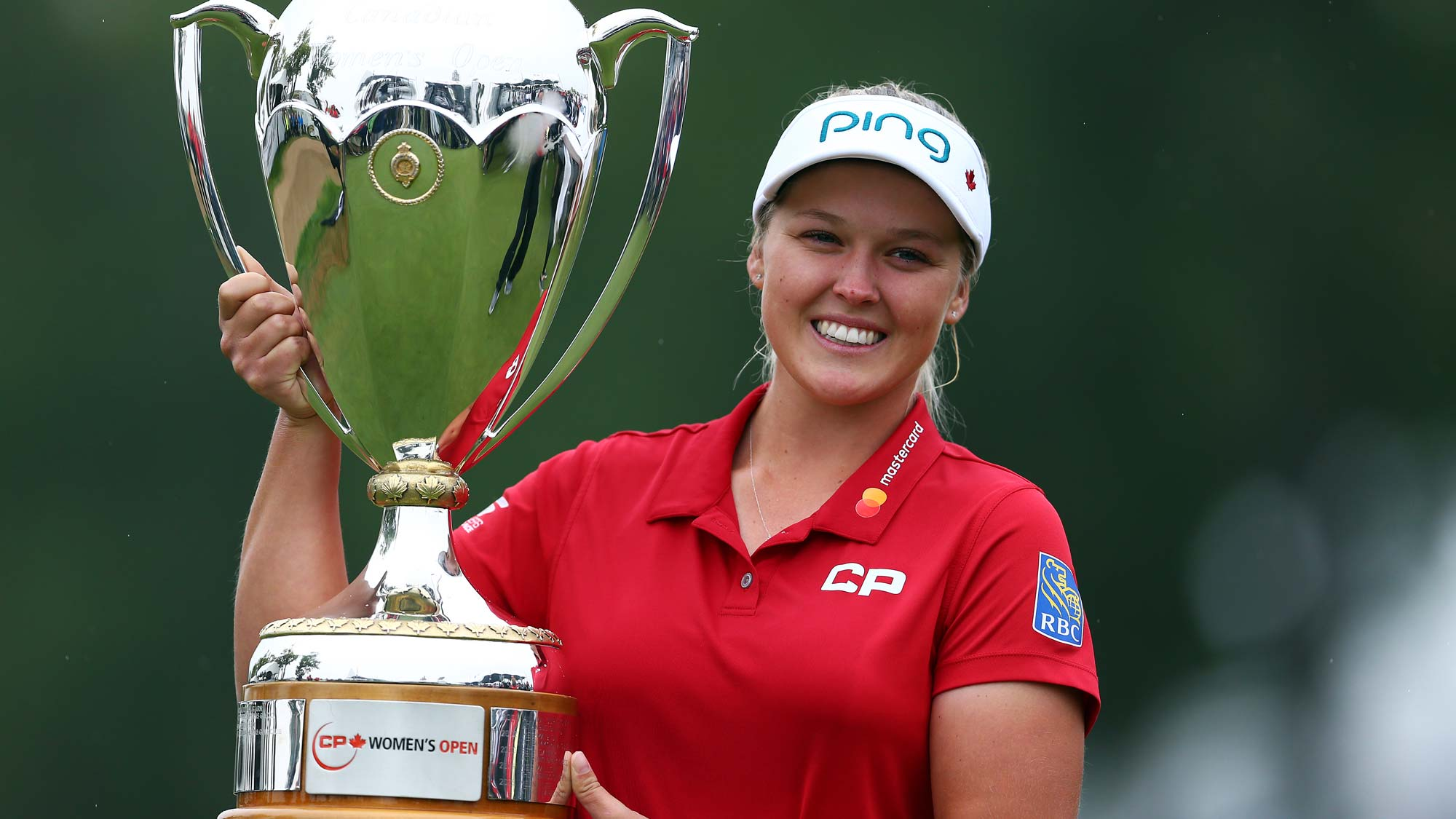 Brooke Henderson of Canada lifts the champions trophy following the final round of the CP Womens Open