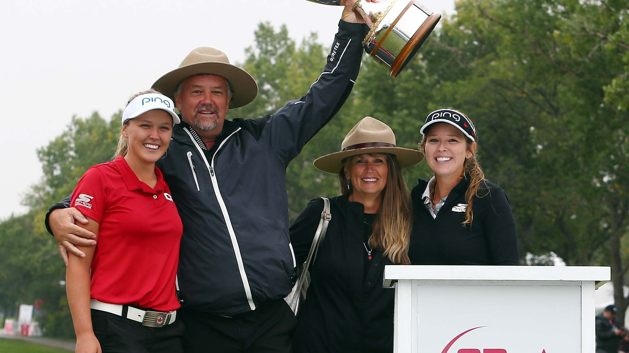 Brooke Henderson of Canada with the champions trophy and her dad, Dave, mother, Darlene and sister & caddie, Brittany, following the final round of the CP Womens Open