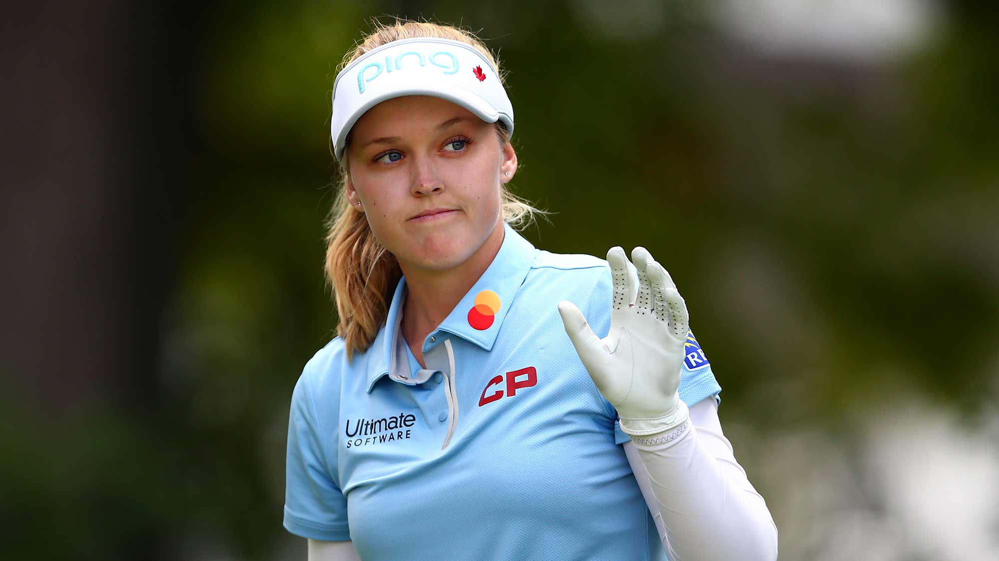 Brooke Henderson of Canada acknowledges the crowd prior to teeing off on the 1st hole during the third round of the CP Women's Open at Magna Golf Club on August 24, 2019 in Aurora, Canada