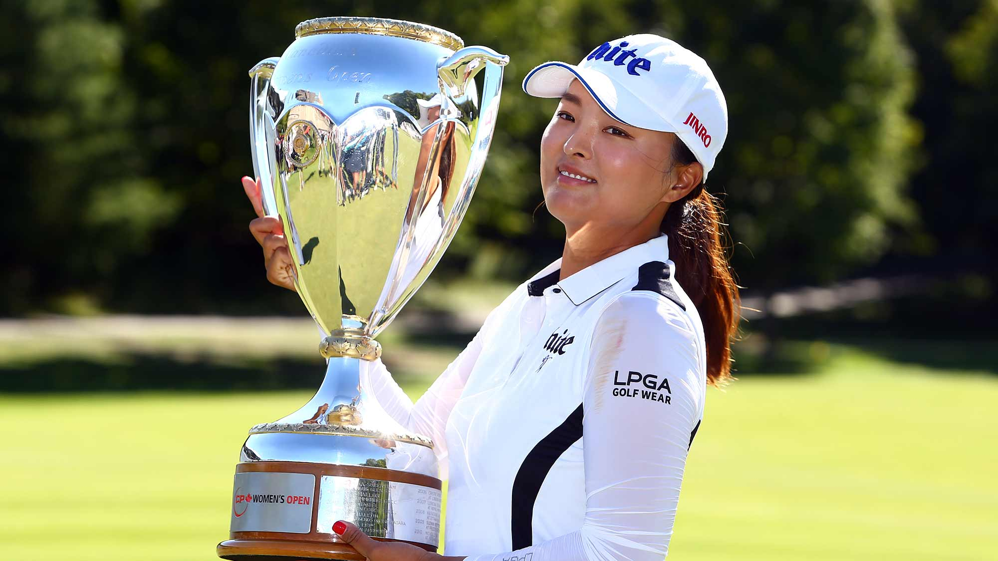 Jin Young Ko of Korea poses with the CP Women's Open Championship Trophy following the final round at Magna Golf Club on August 25, 2019 in Aurora, Canada