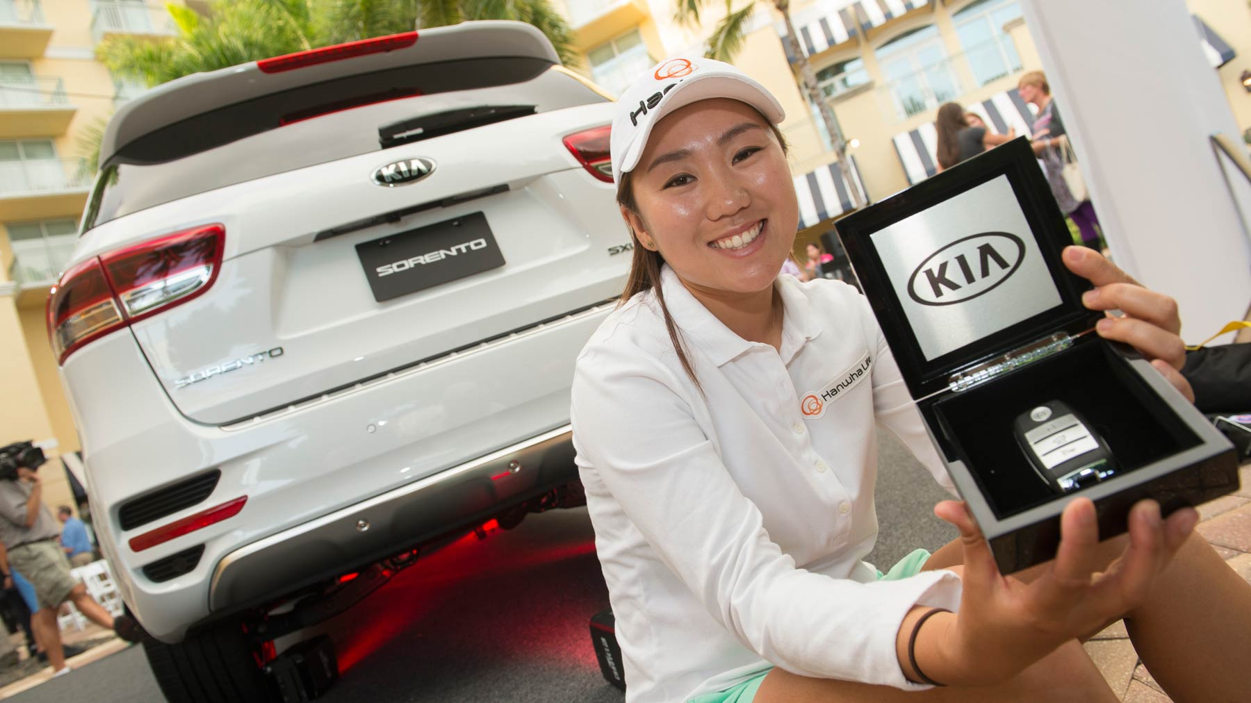2015 Kia Community Assist Award Winner I.K. Kim with her new Kia Sorento