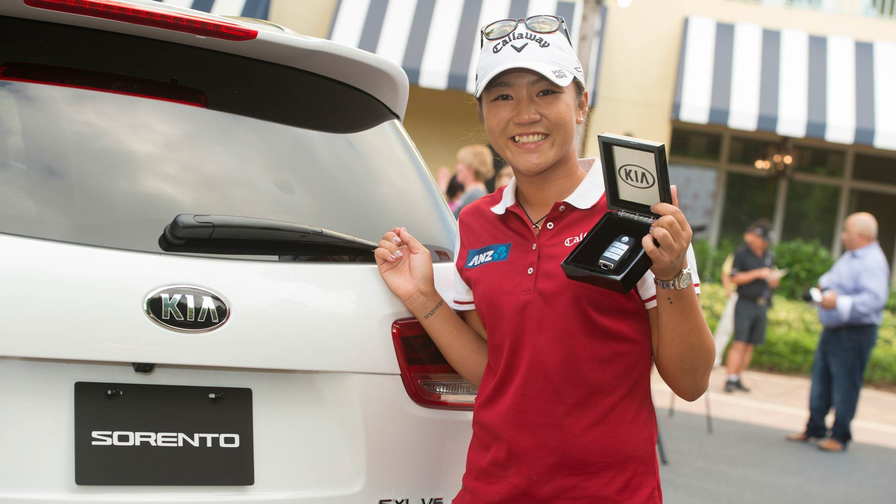 2015 Kia Drive to the Top Award Winner Lydia Ko with her new 2016 Kia Sorento