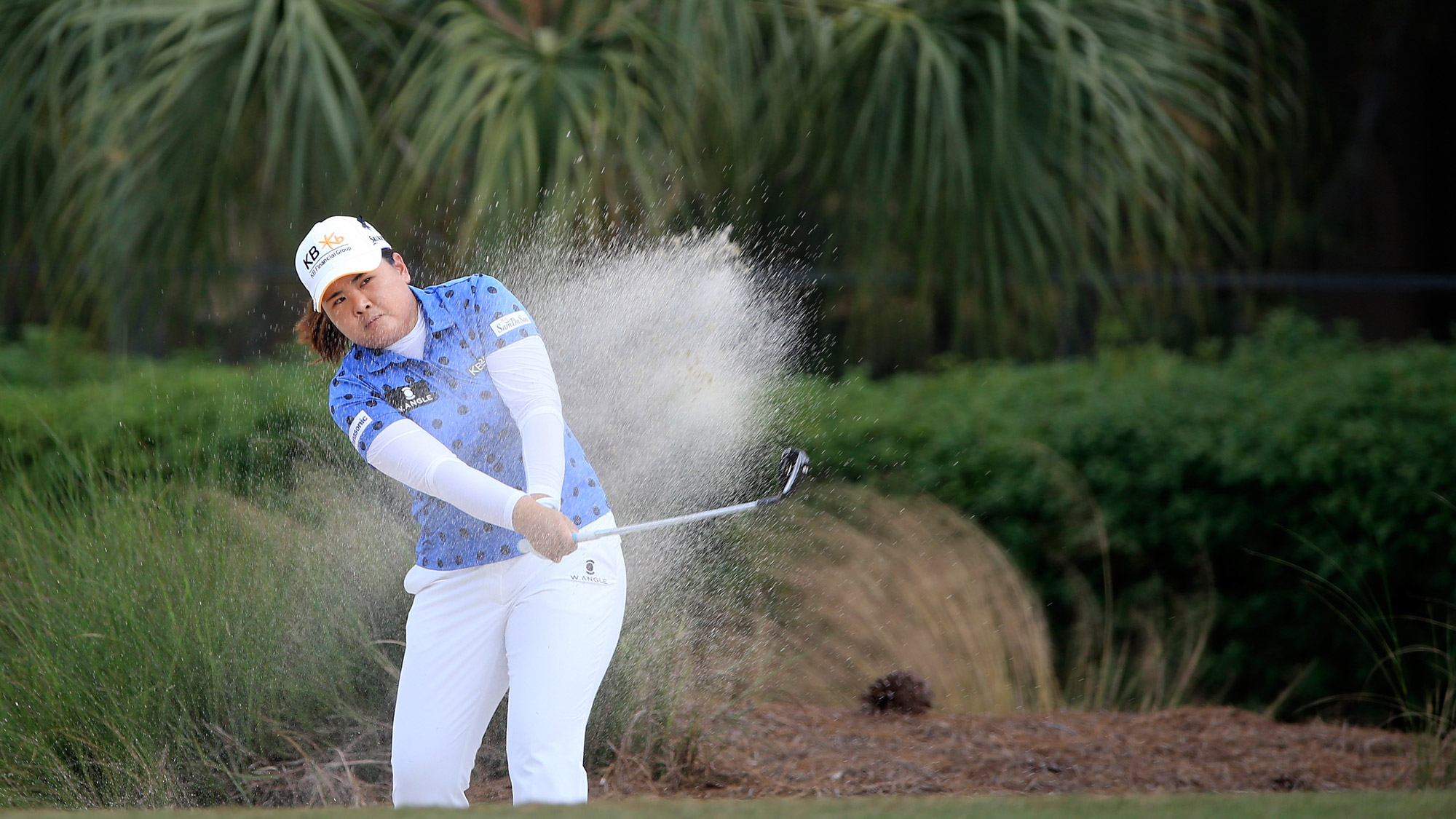 Inbee Park of South Korea plays a shot on the sixth hole during the first round of the CME Group Tour Championship at Tiburon Golf Club