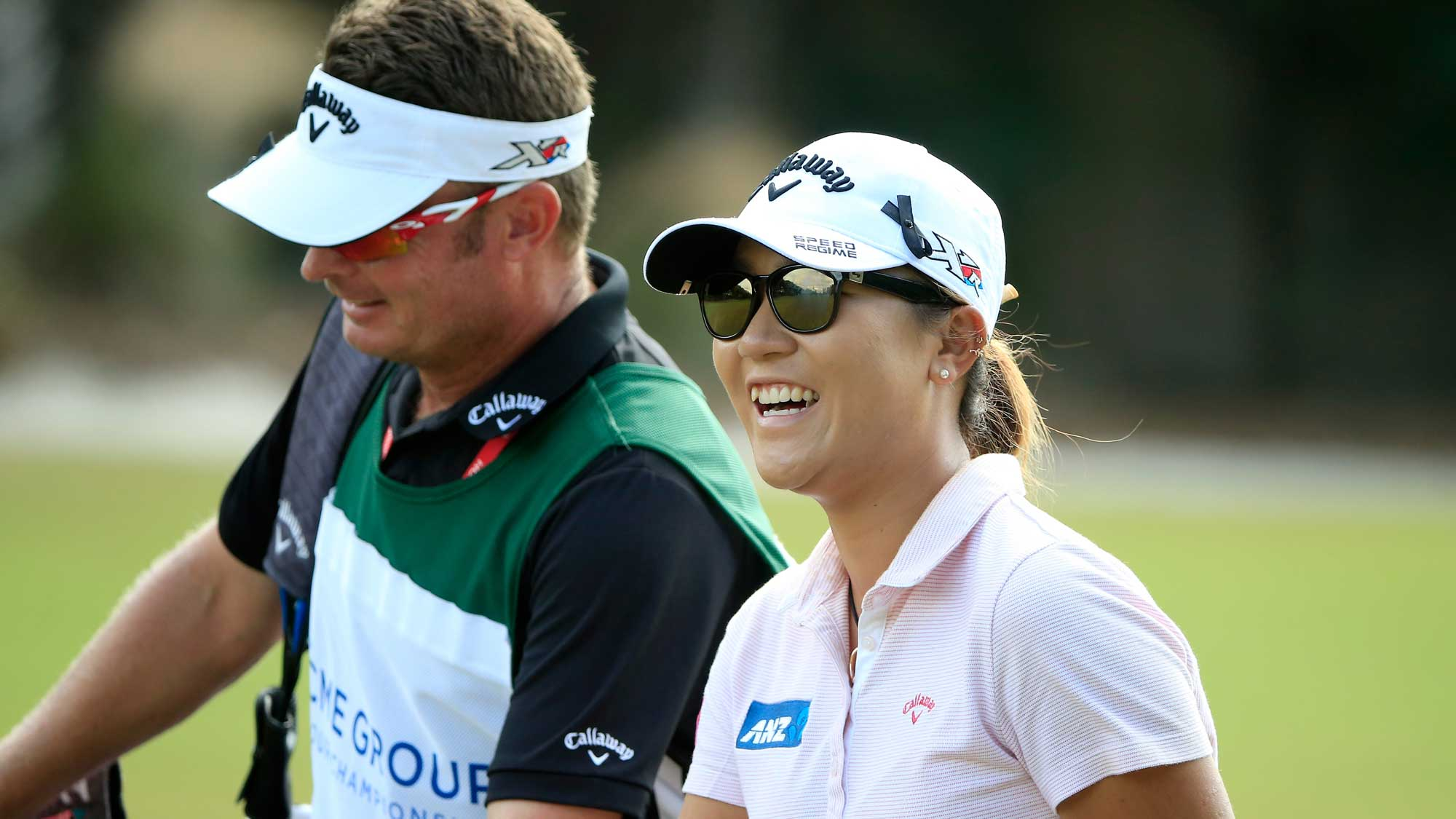 Lydia Ko of New Zealand smiles as she walks down the second hole during the second round of the CME Group Tour Championship at Tiburon Golf Club