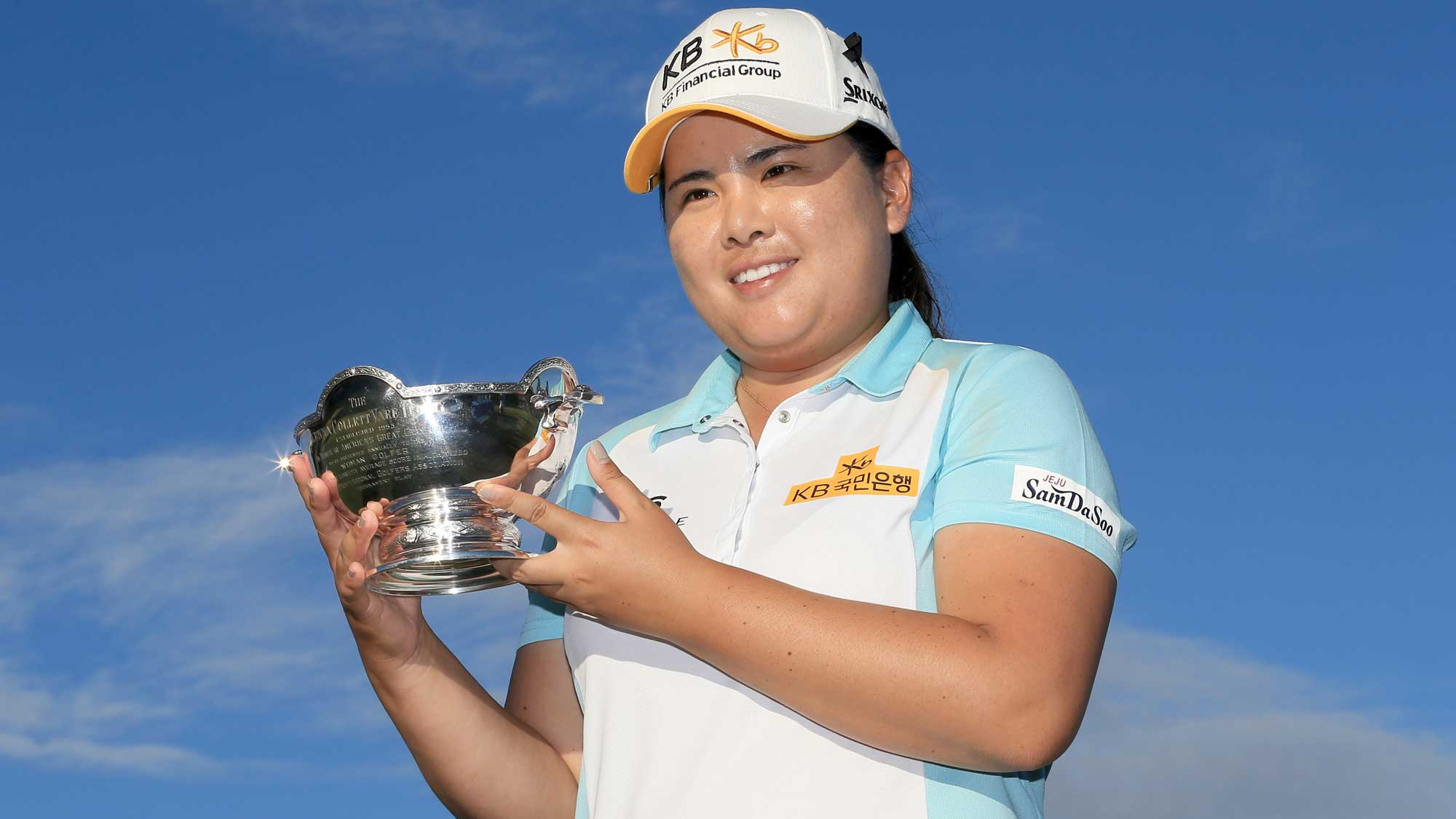 Inbee Park of South Korea poses with the Vare trophy during the final round of the CME Group Tour Championship at Tiburon Golf Club