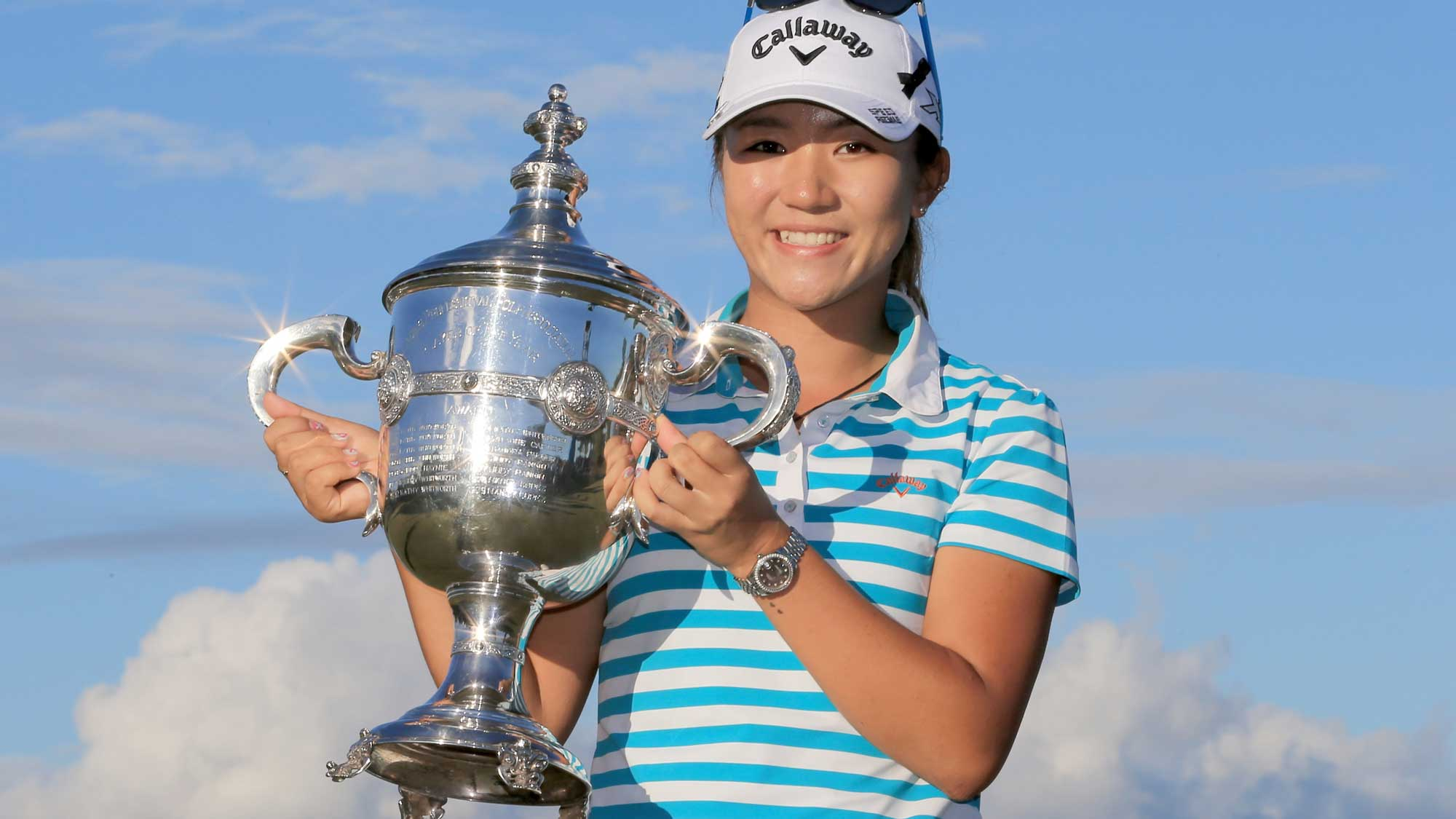 Lydia Ko of New Zealand poses with the Rolex Player of the Year trophy during the final round of the CME Group Tour Championship at Tiburon Golf Club
