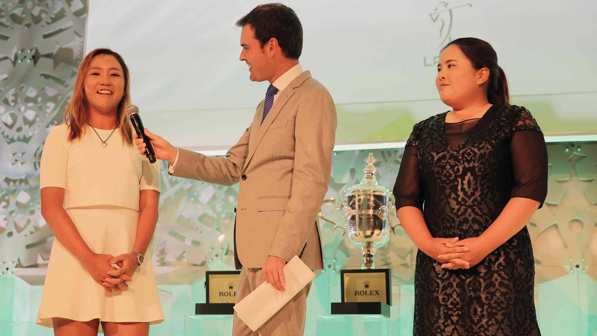 Tom Abbott of Golf Channel chats on stage with Lydia Ko of New Zealand (L) and Inbee Park of South Korea during the LPGA Rolex Players Awards at the Ritz-Carlton, Naples