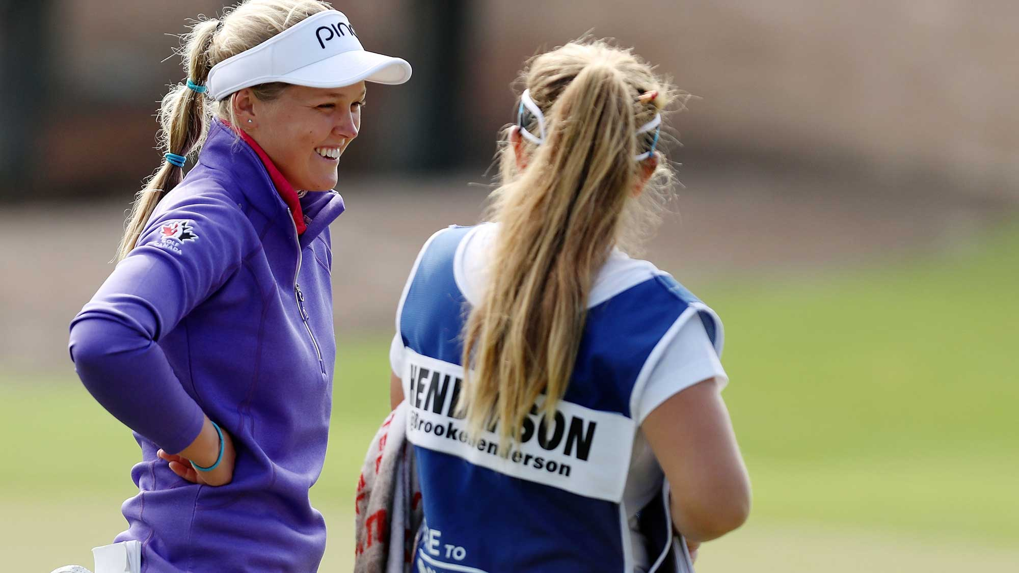 Brooke Henderson of Canada talks with her caddie on the 11th hole during the second round of the CME Group Tour Championship at Tiburon Golf Club