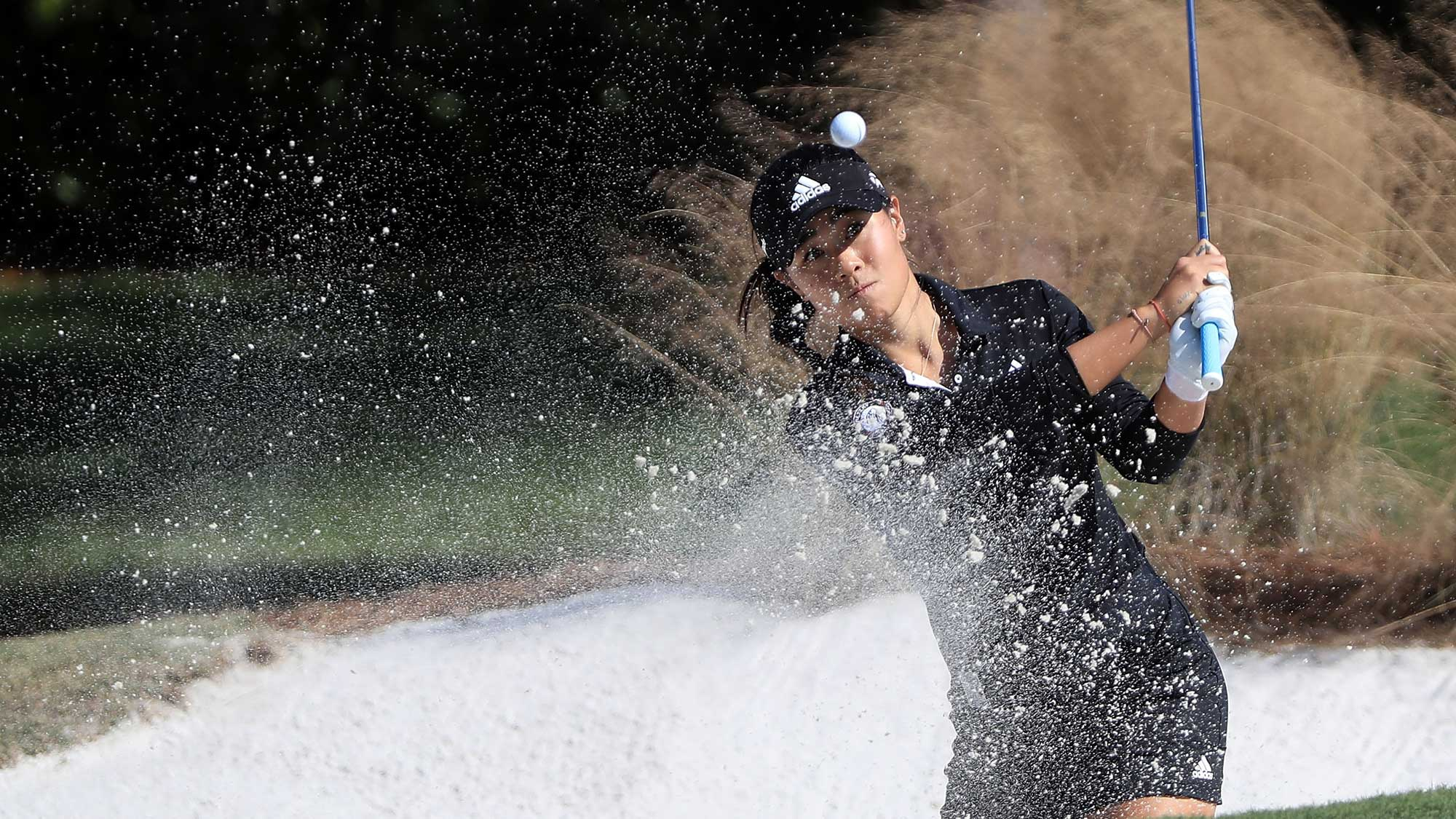 Danielle Kang plays her shot out of the bunker on the sixth hole during the second round of the CME Group Tour Championship at Tiburon Golf Club