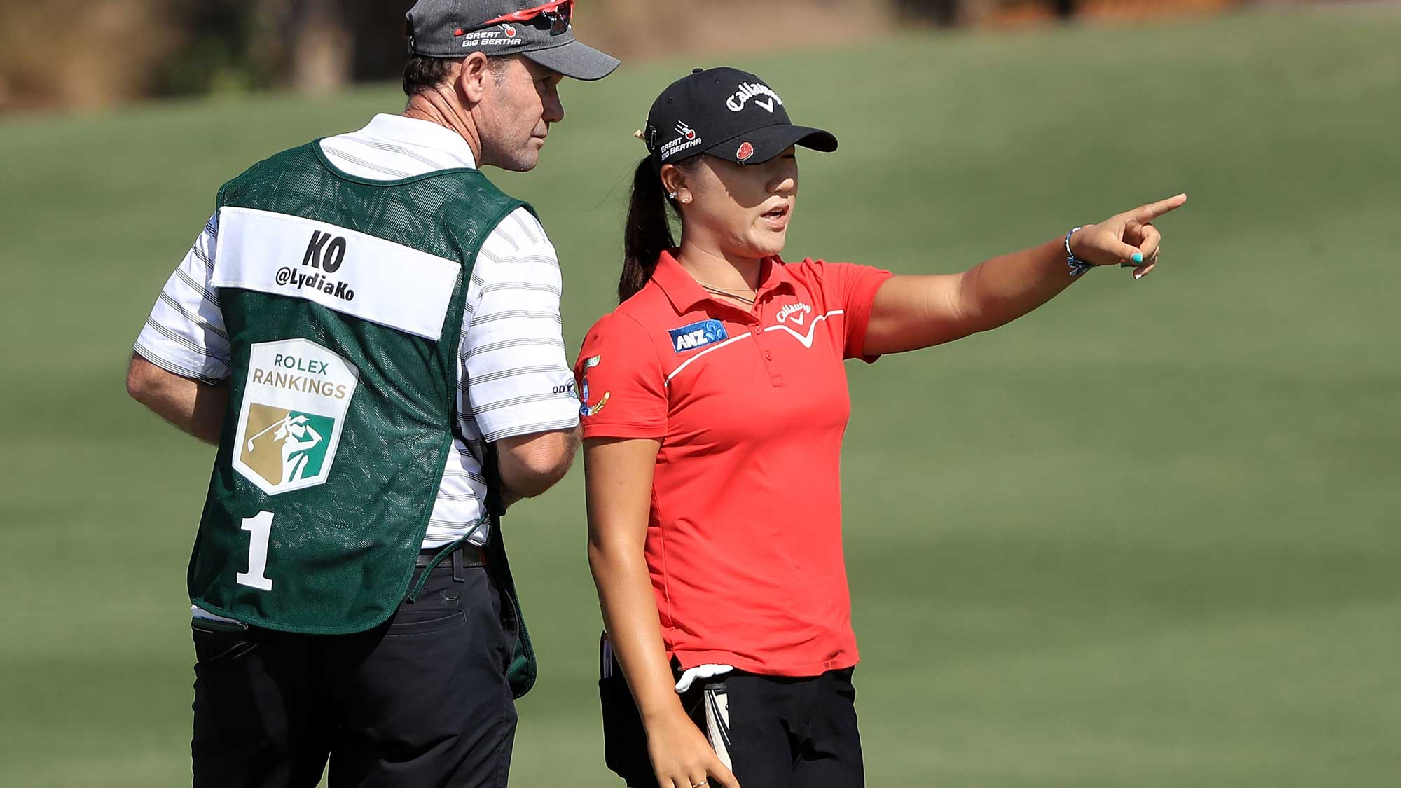 Lydia Ko of New Zealand talks with her caddie on the eighth hole during the second round of the CME Group Tour Championship at Tiburon Golf Club