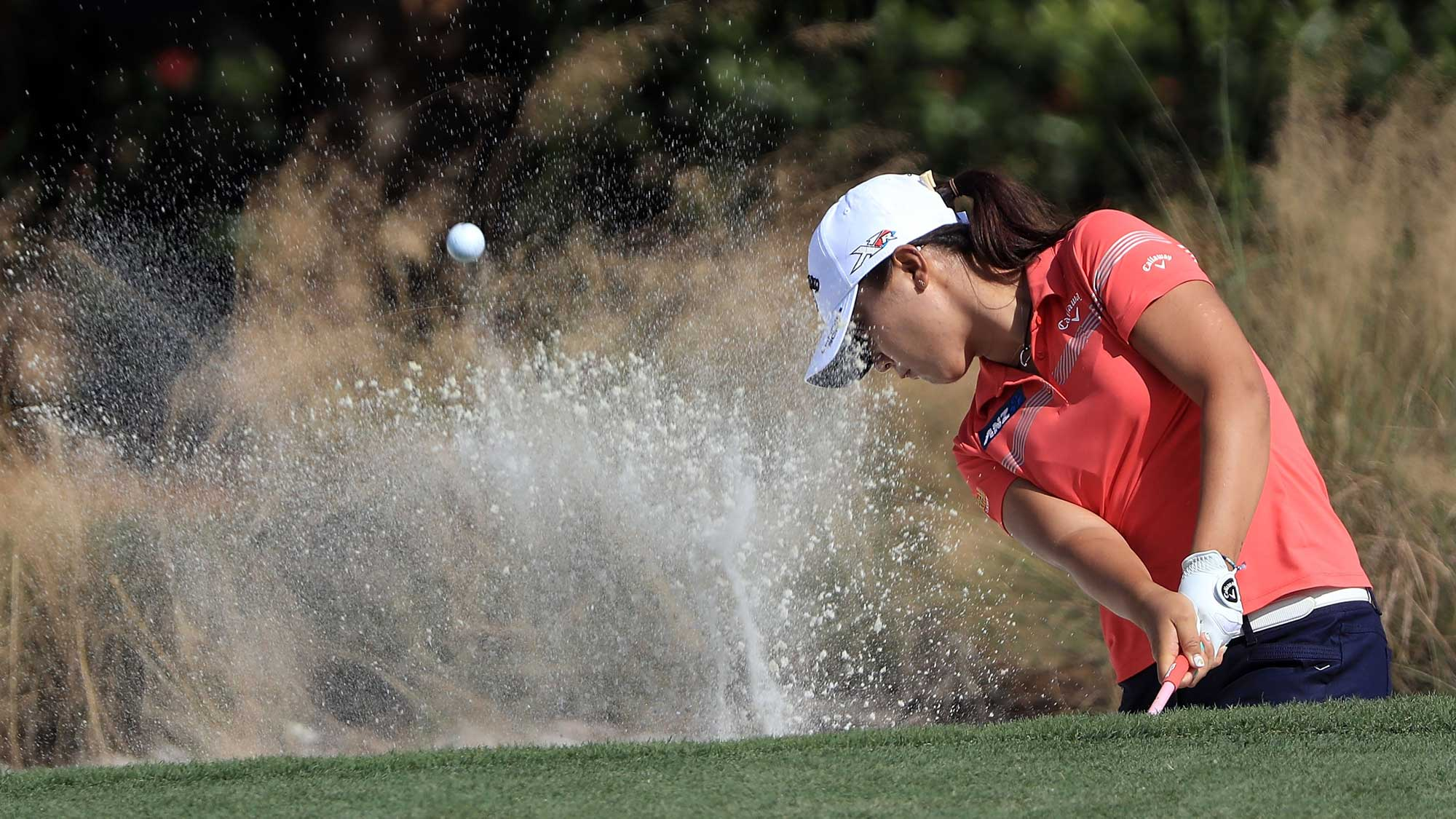 Lydia Ko of New Zealand plays her shot out of the bunker on the sixth hole during the third round of the CME Group Tour Championship