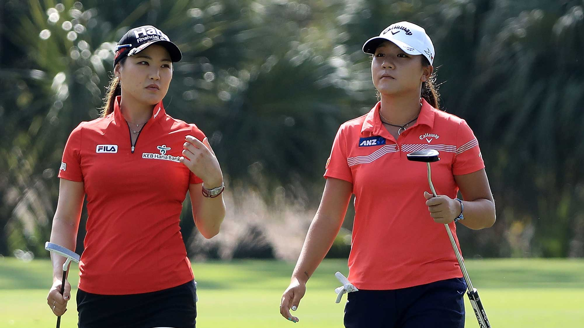 So Yeon Ryu of South Korea and Lydia Ko of New Zealand walk up the second fairway during the third round of the CME Group Tour Championship