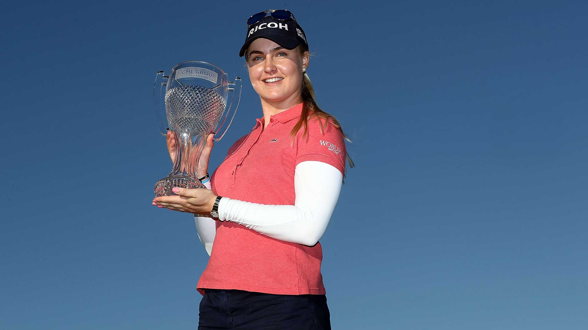 Charley Hull of England poses with the CME Tour Championship trophy during the final round of the CME Group Tour Championship at Tiburon Golf Club