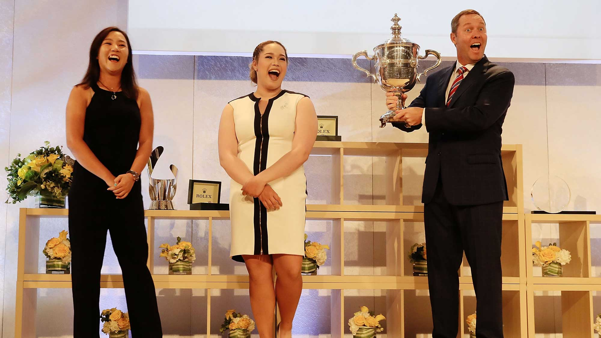 LPGA players Lydia Ko of New Zealand and Ariya Juntanugarn of Thailand along with LPGA commissioner Michael Whan pose with the Player of the Year Award which has yet to be determined at the LPGA Rolex Players Awards
