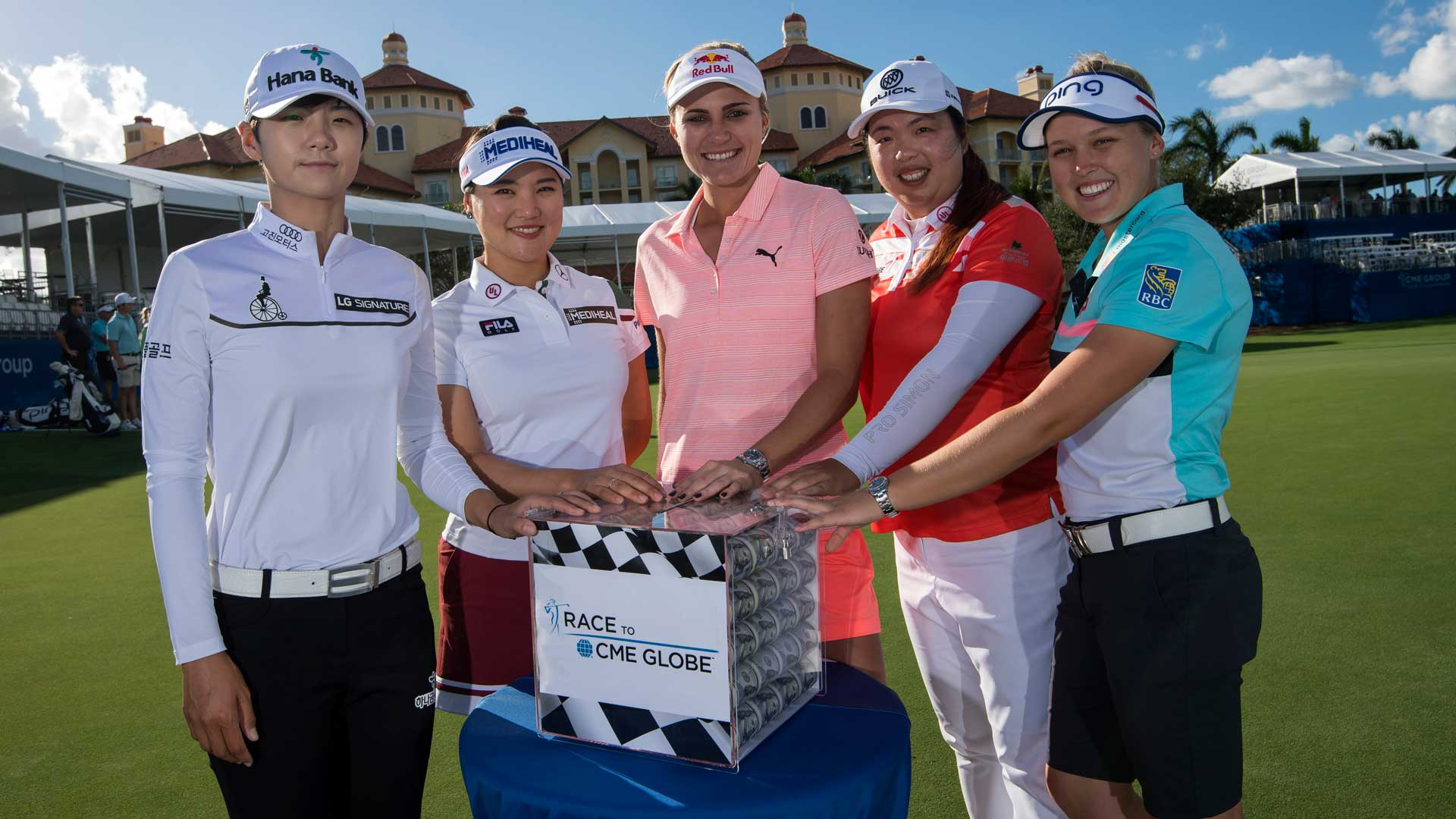 From Left to Right: Sung Hyun Park, So Yeon Ryu, Lexi Thompson, Shanshan Feng and Brooke Henderson pose with the Race to CME Globe $1 Million prize