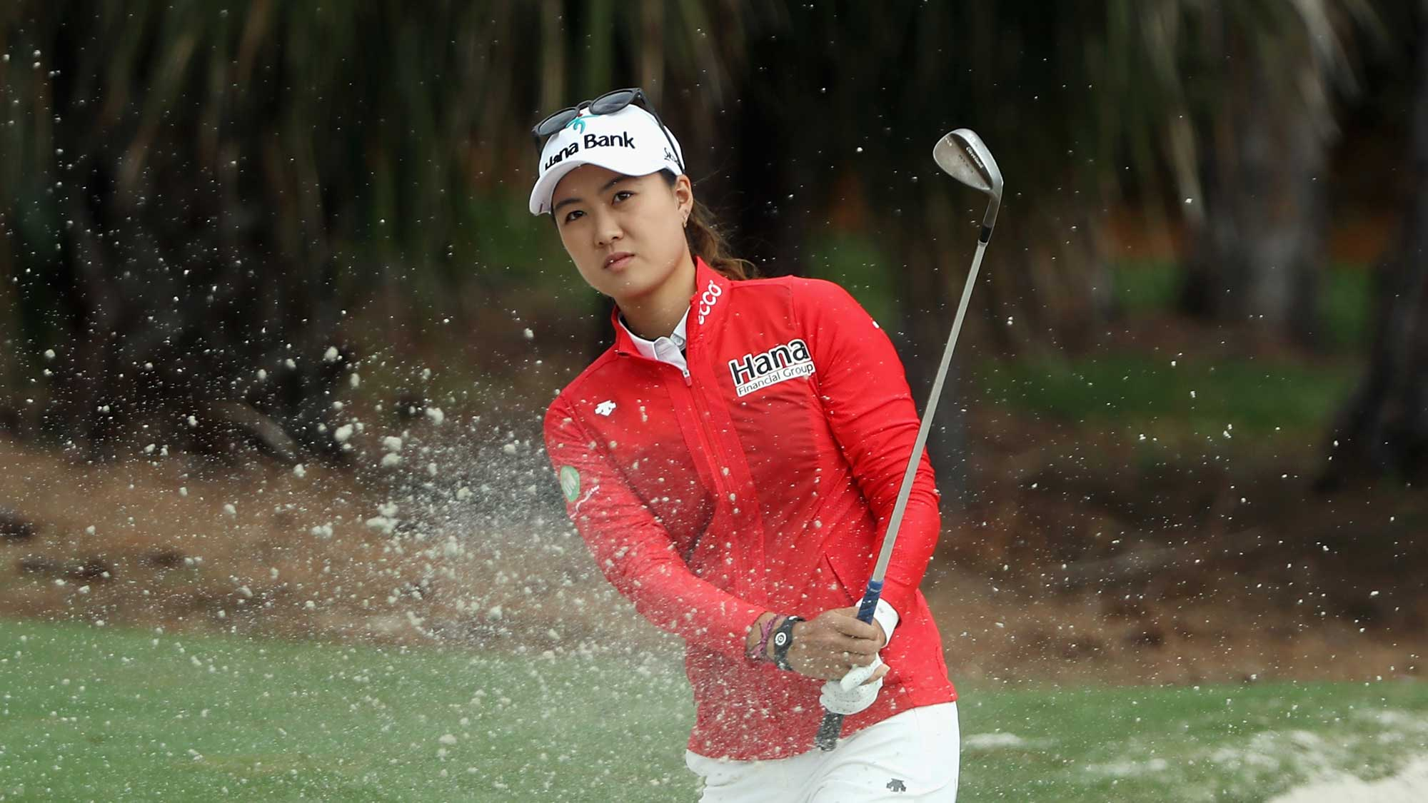 Minjee Lee of Australia plays a shot from a greenside bunker on the sixth hole during round one of the CME Group Tour Championship