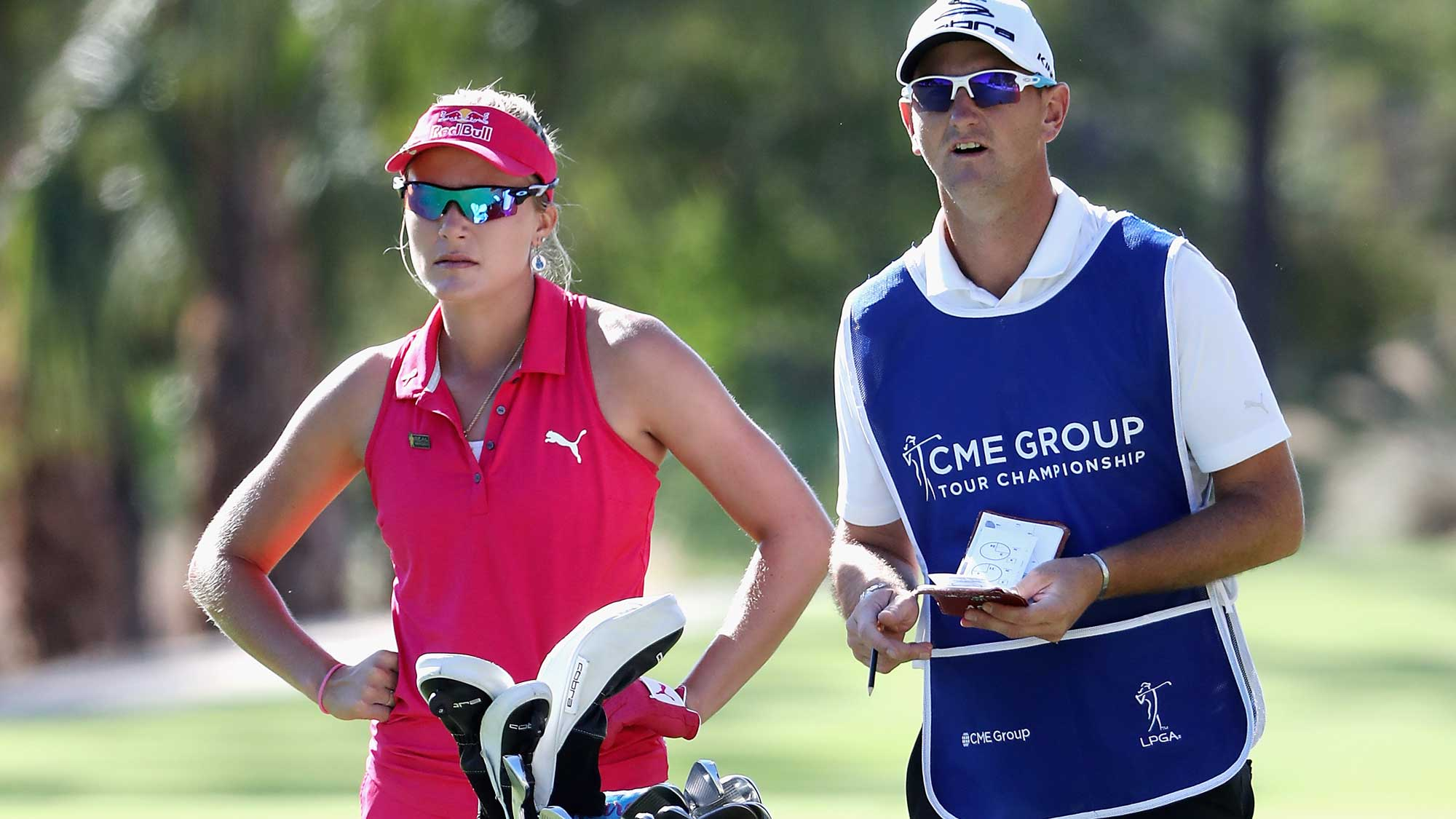 Lexi Thompson of the United States stands with caddie Kevin McAlpine on the second hole during round three of the CME Group Tour Championship