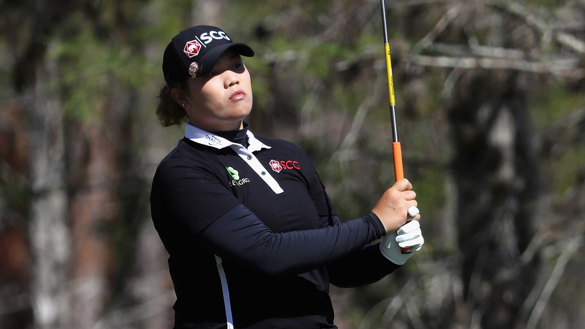Ariya Jutanugarn of Thailand plays her shot from the eighth tee during the final round of the CME Group Tour Championship