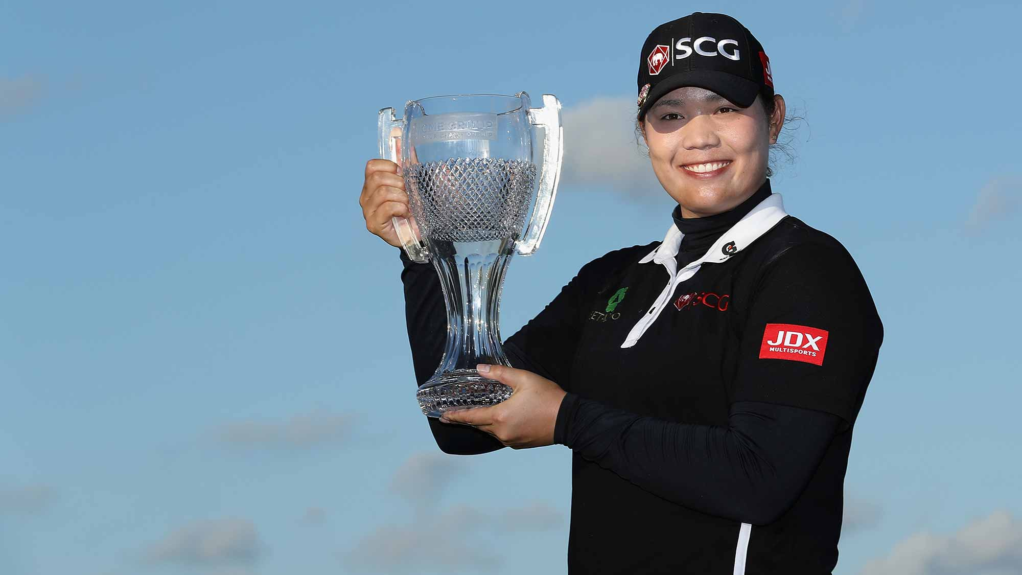 Ariya Jutanugarn of Thailand poses with the CME Group Tour Championship trophy after the final round of the CME Group Tour Championship
