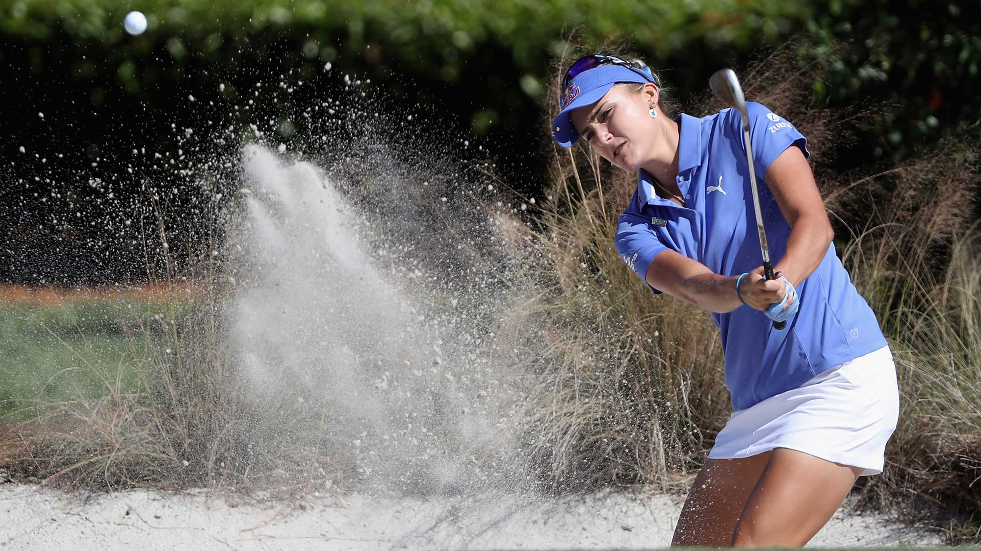 Lexi Thompson of the United States plays a shot from a bunker on the sixth hole during the final round of the CME Group Tour Championship