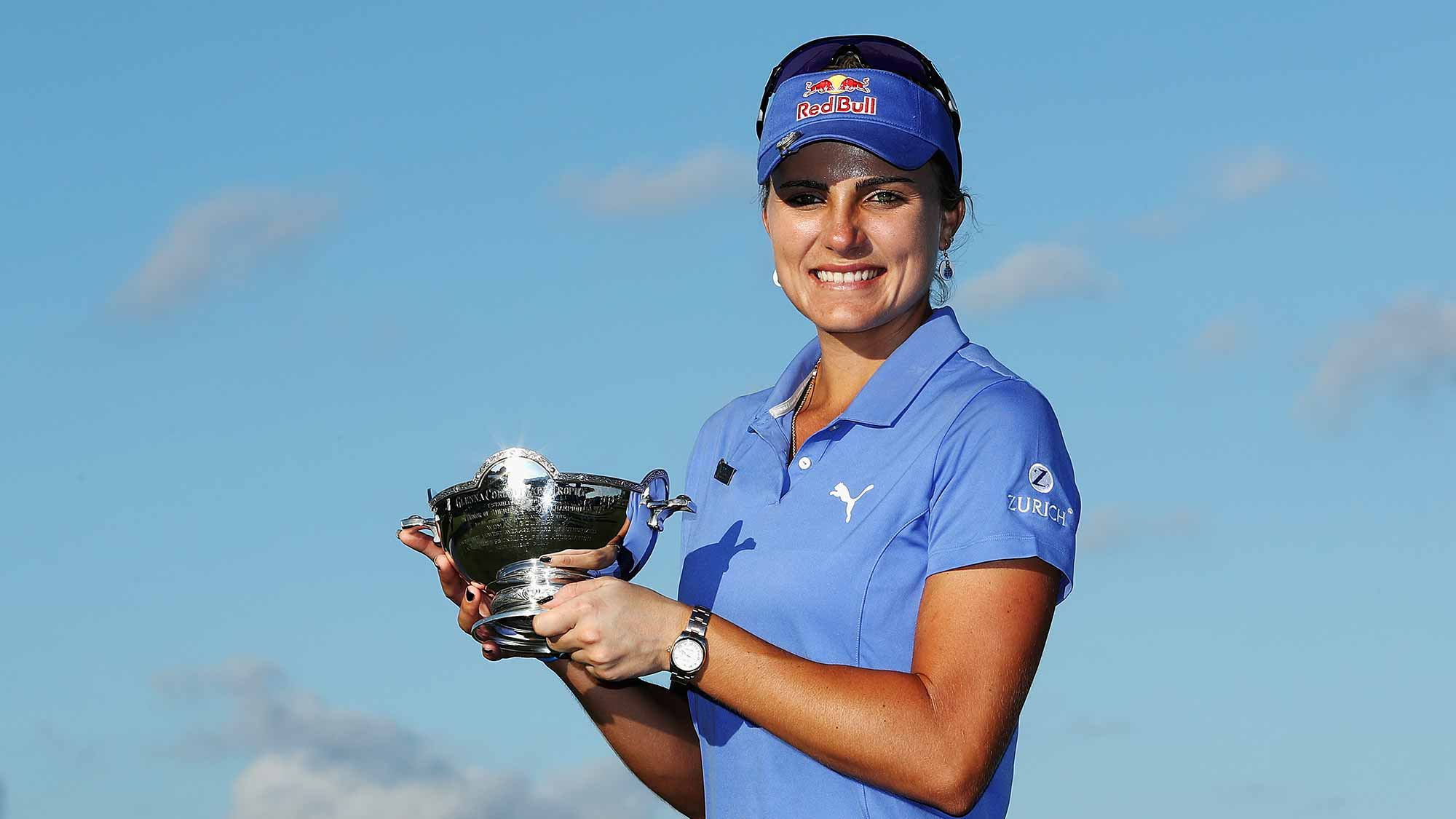 Lexi Thompson of the United States poses with the Vare Trophy after the final round of the CME Group Tour Championship