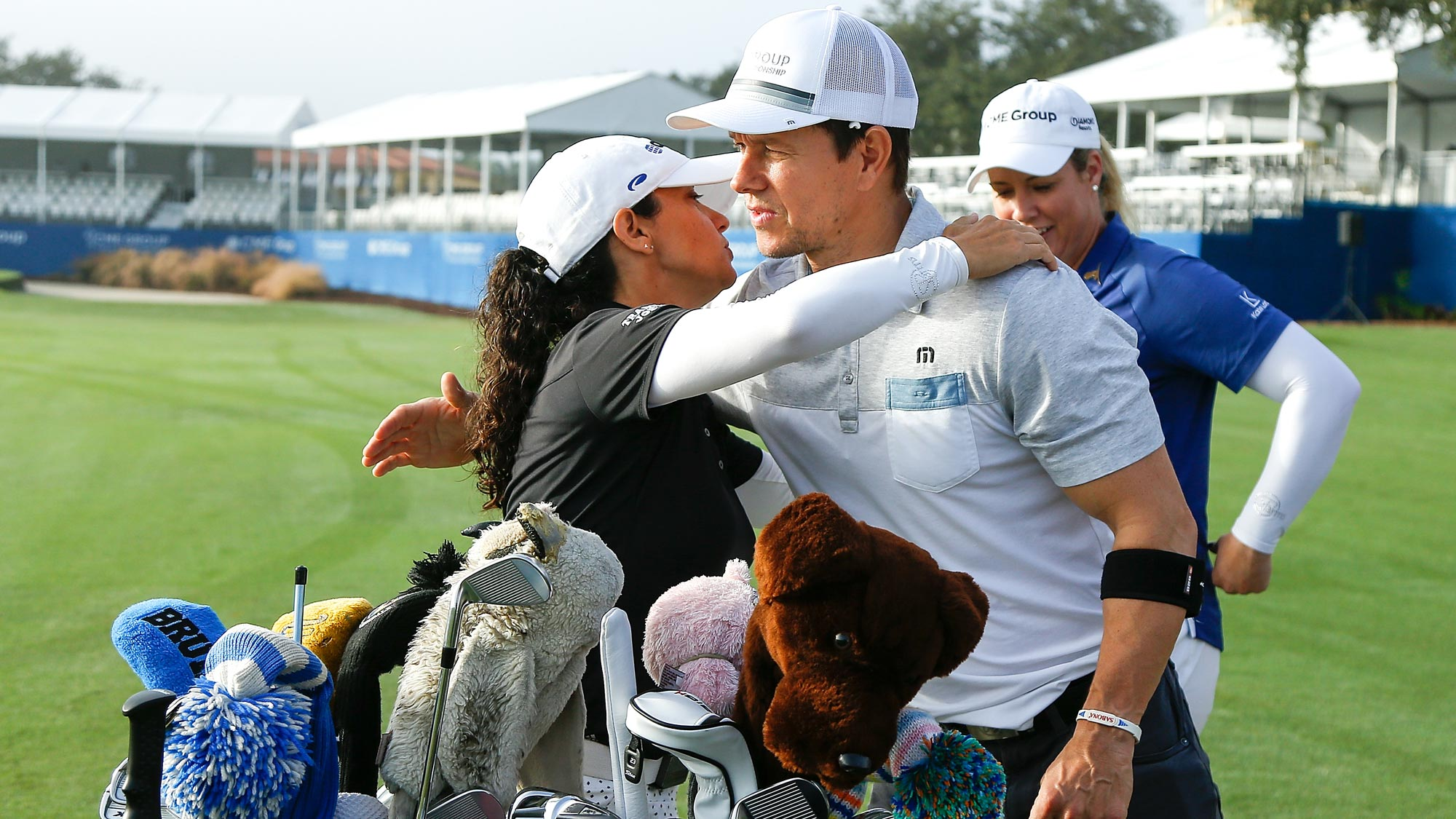 Actor Mark Wahlberg greets LPGA golfer Mo Martin prior to the CME Group charity event to benefit St. Jude Children's Research Hospital prior to the LPGA CME Group Tour Championship