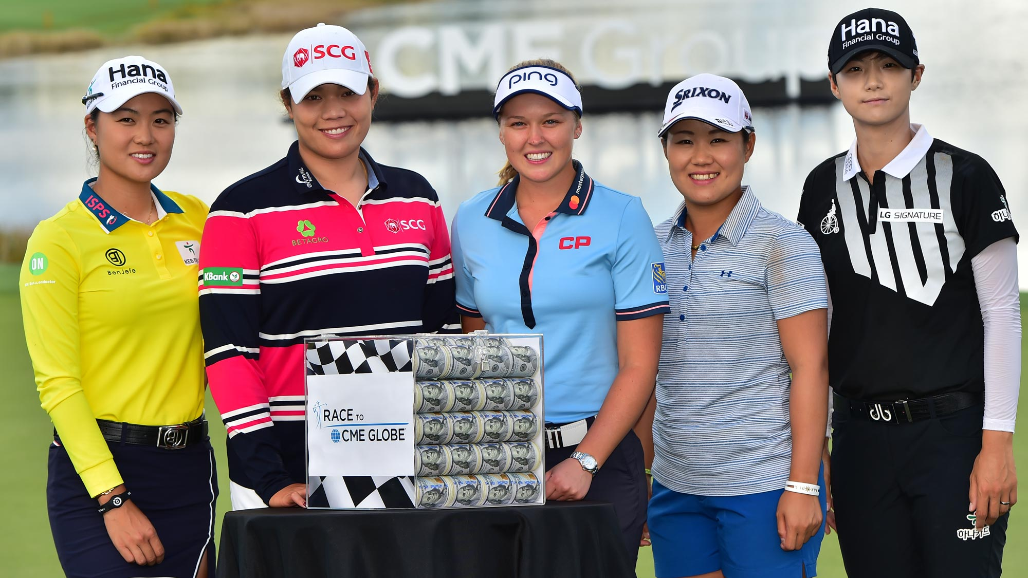 (left to right) Minjee Lee of Australia, Ariya Jutanugarn of Thailand, Brooke Henderson of Canada, Nasa Hataoka of Japan and Sung Hyun Park of South Korea pose for a photo with the Race for the CME Globe Money Box on the 18th green prior to the LPGA CME Group Tour Championship