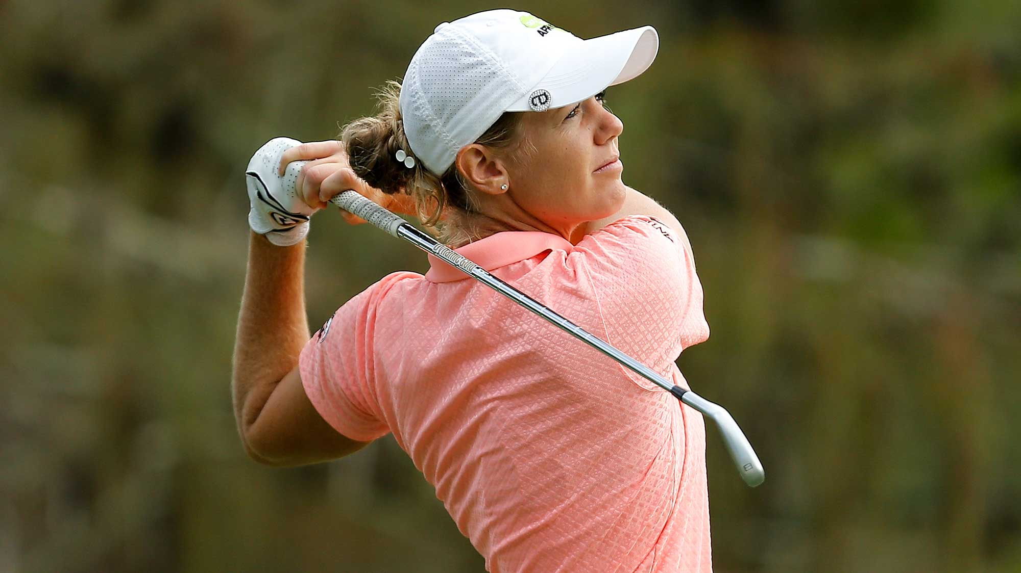 Amy Olson plays her shot from the eighth tee during the first round of the CME Group Tour Championship