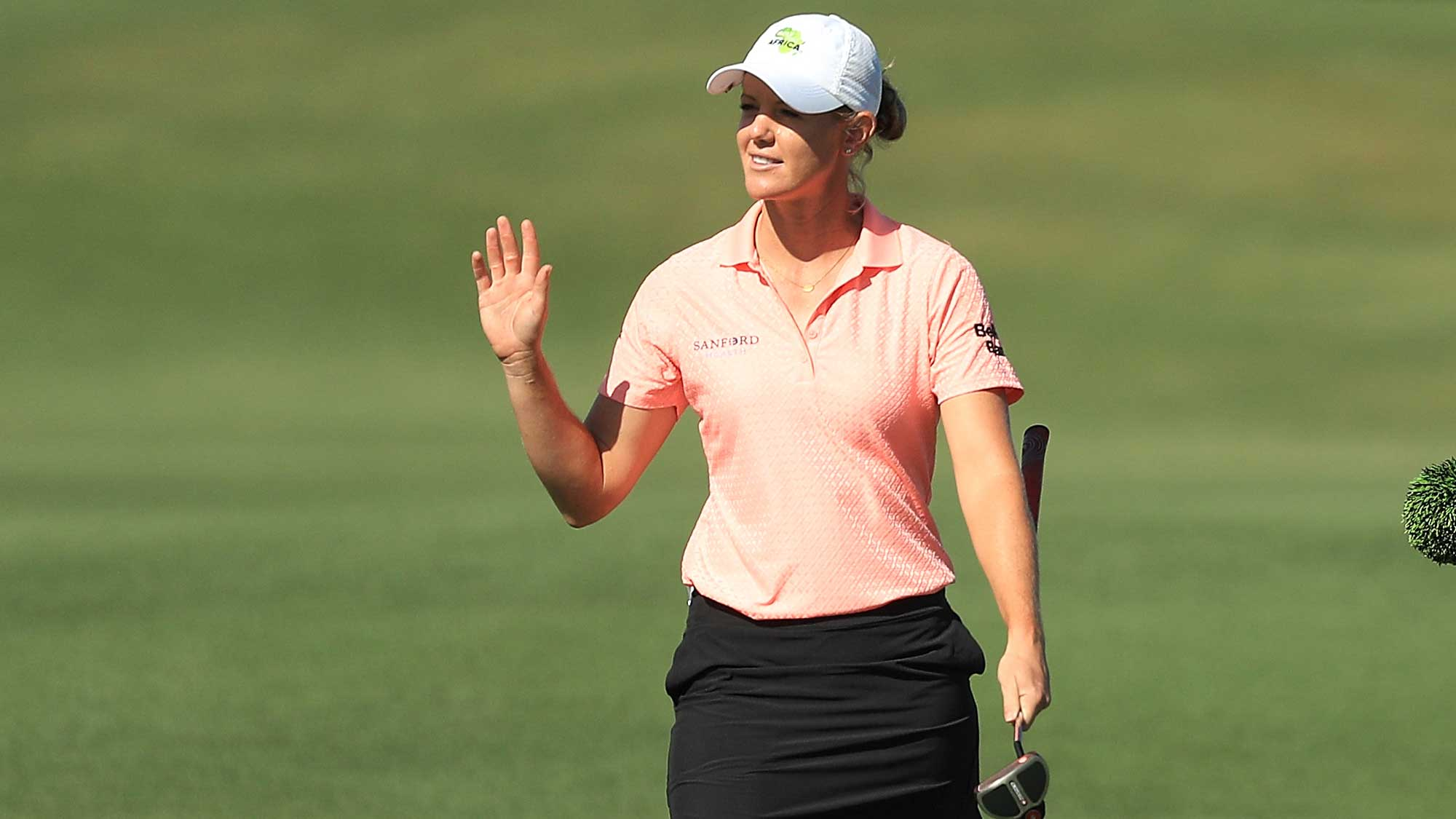 Amy Olson reacts as she walks up the 18th fairway during the first round of the CME Group Tour Championship