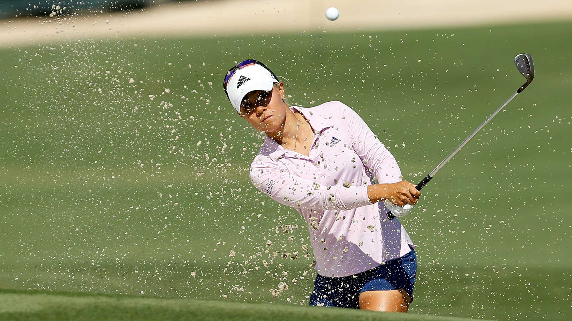 Danielle Kang plays a shot from a bunker on the ninth hole during the first round of the CME Group Tour Championship