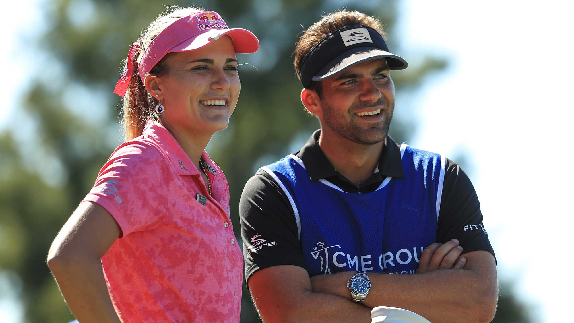 Lexi Thompson talks with her brother and caddie, Curtis, on the fourth tee during the third round of the LPGA CME Group Tour Championship
